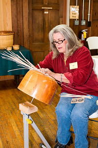Gail prepares staves over a mold for the second largest basket