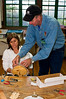 Alan, our instructor, gives Julie some pointers on weaving...