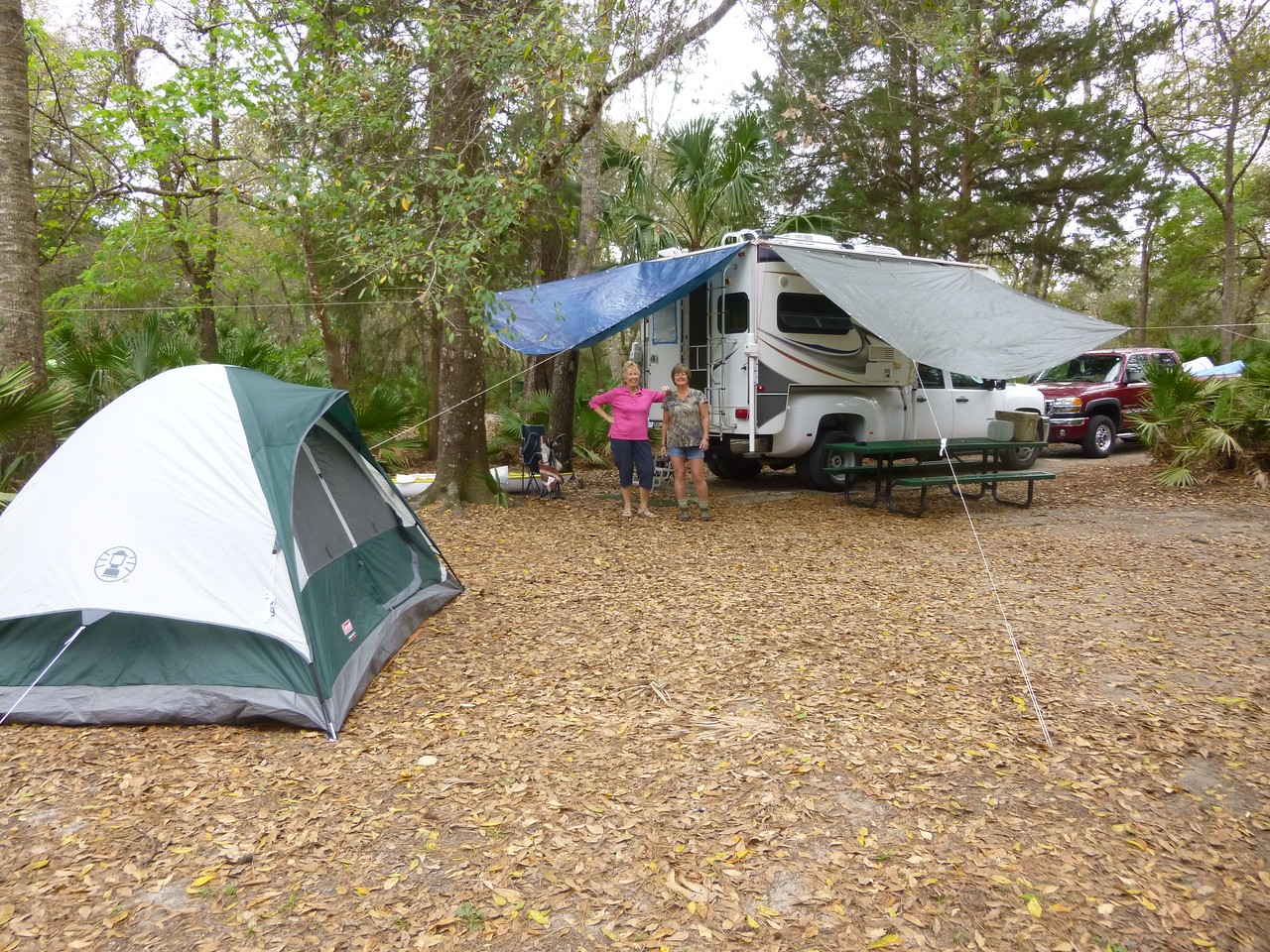 Record #434   DATE: 3/12/2017  DAY: Sun  ST:  FL NAME:  Juniper Springs CG LOCATION:  Ocala NF SITE #:   60    COST:   $11.55+$4.50 reserve fee water, dump, showers   This trip was the Windyakers camping/kayaking trip to Juniper Springs.  There were 16 campers at 5 CG sites and 8 B&B/motel gals.  On I75 after Wildwood, the traffic came to stop/go for miles with over 30 miles to go to Ocala.  Finally able to exit and cut over to FL35.  This was the same traffic mess I had last year going to Juniper Springs.  I was the first to arrive at the CG.  It was an easy back into my site and it was level so no blocks.    Rain forecast was 70% for the next 2 days, so the first item was to put up the tarps.  Yesterday, I made a halyard system for the starboard side of the camper, just like I have for the back of the camper.  Now, both tarps can be put up without climbing up on the roof.  This was a safety issue that I needed.  Lori & Betty arrived before 3pm.  It was nice to have the extra help unloading my kayak from inside the camper.  I can do it myself, but it is sure easier with help.    The 3 of us dragged the picnic table next to the camper so it would be under the tarp from the rain.  It was spitting rain.  Plans were for Sandy Huff & SarahBeth Reeves to join us for dinner and they were to bring appetizers.  We were sure getting hungry when they still were not at the CG by 5pm  Finally, with a frantic call and text message WE ARE STARVING, we discovered they were still at their motel.  They finally arrived at 5:30pm with enough appetizers to feed an army!  Betty made chicken chili for dinner, and we ate chocolate brownies that SB brought for dessert around the campfire.   When the B&B gals arrived to join in dinner and social activities with the rest of the campers, they just pulled off the pavement to park where they thought was ok.  The CG rangers were very stern that any vehicle off the pavement was $75 fine per tire.  Needless to say, we moved all the cars around to 