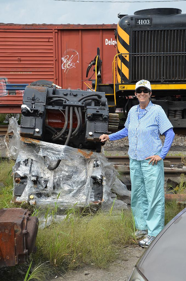 6043: Gail next to a (new?) traction motor. These are the electric motors that actually turn the driving wheels of the locomotive. Big.
