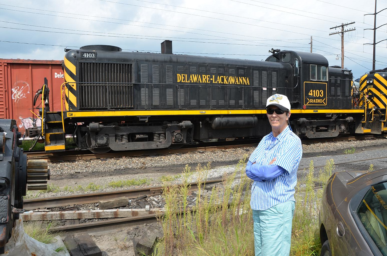 6044: Gail infront of #4103, Alco RS3 (her favorite type of diesel), built 1952 for the Delaware & Hudson.