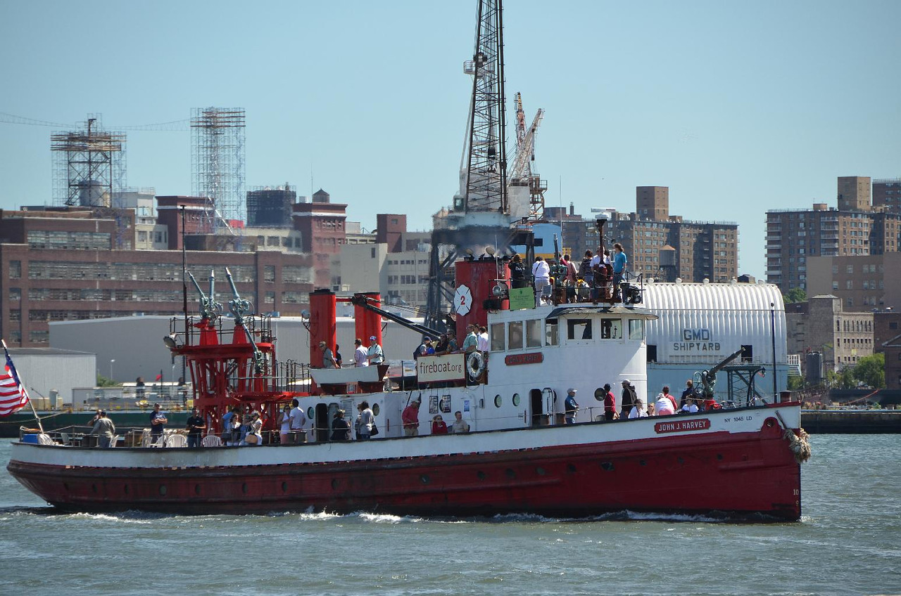 A real fireboat being  used as a party boat. I love New York (from a safe distance).