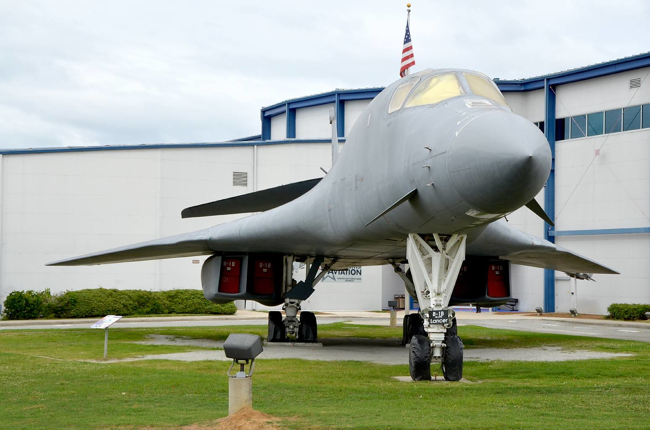 """3548 - B-1B """"Lancer"""" bomber, guarding the entrance to the Museum. So sleek it doesn't look that big right away, but then you walk under it, and around it. BIG! Supersonic, carries as much as the B-52, just as far."""