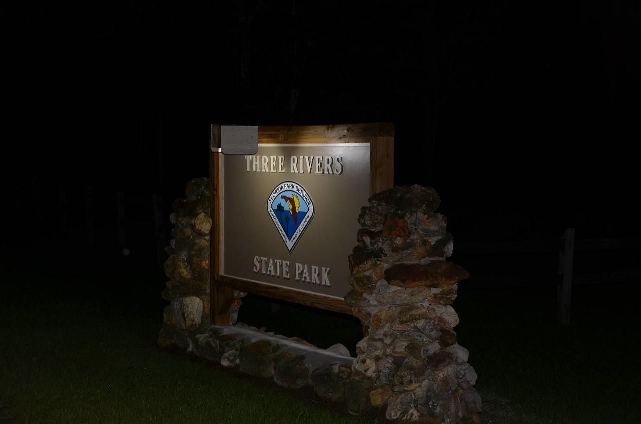 """Well, we found the campground, now all we had to do was find the campsite to park in for the night. The lights on the sign are the only """"streetlights"""" in the campground!"""