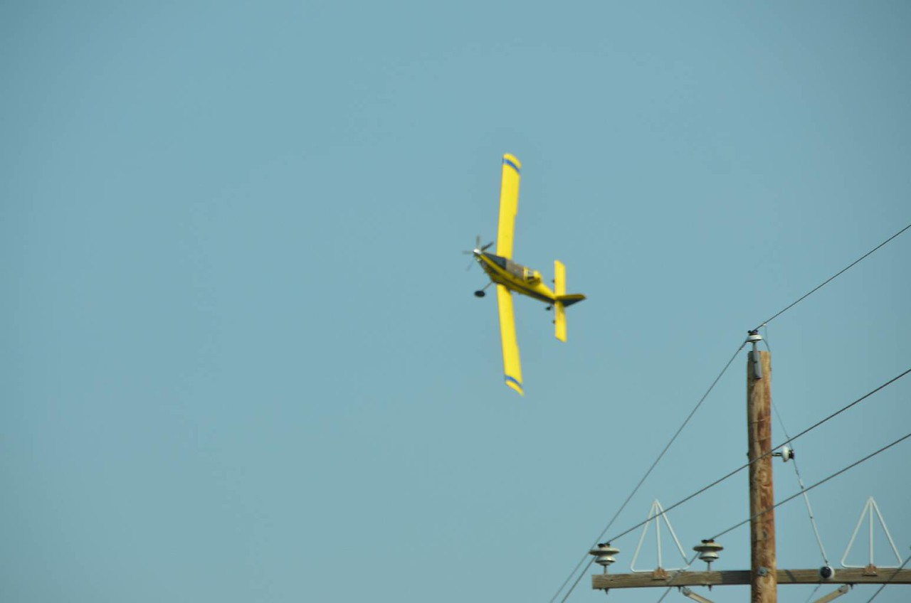 """On our final leg to Colorado, much to our surprise, and then delight, we were """"attacked"""" by this airplane, which turned out to be just a cropduster, working on Sunday..."""