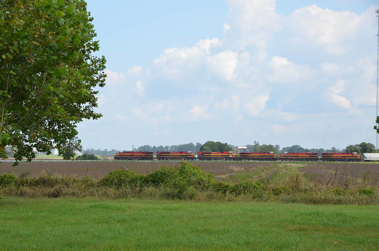 Saw this Westbound train just start to enter the bridge to cross the Mississippi. We're at a rest stop about 20 miles west of the river, and it caught up to us. Our 'train-fix' for the day.
