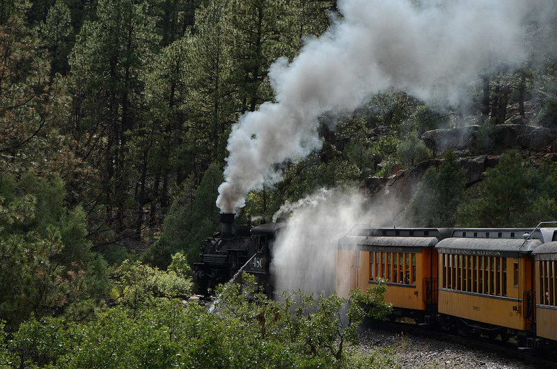 7810 - Not only didn't didn't the locomotive need additional water for the trip downgrade, it blew out it's flues several times along way to help keep them free of sediment and minerals that are in the water. Glad we weren't in the first car.