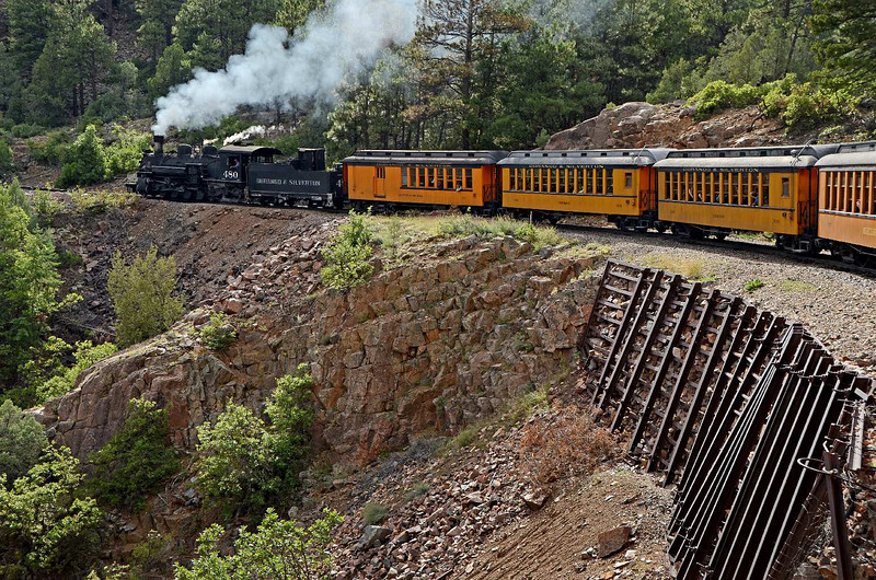 7857 - Another great view of the train and it's mountain environment. Cribbing holding up the side of the hill (and the train) is old train rail bolted together.