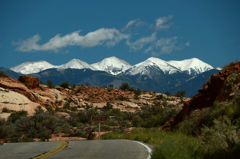 8135 - As we left the Arches National Park, we looked back and saw all this snow on the distant peaks to the East. That snow wasn't there yesterday! All part of the storm system we went through yesterday! (The snow was mostly gone the next day!)