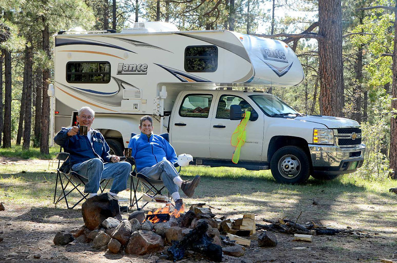 8979 - I looks like ONCE every trip we take, we build a fire and celebrate life together. For lunch we roasted some hotdogs over it. Wonderful! The yellow thingy hanging from the trucks mirror is a safety vest that my sister Cathy gave us, to help prevent hunters from thinking WE'RE food and shooting us! (Lot's of gunfire in the area)