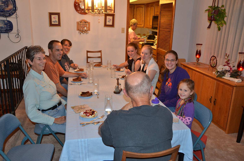 9257 - Family dinner with (clockwise from bald spot): Gail, Gail's nephew Jon, Gail's Neice Julie, Julie's daughters Katie & Megan, Jon's wife Kimberly, and (heart be still..)  Rachael. That's Jim's bald spot is in the forground, Ellen is hiding in the Kitchen.