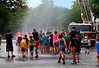 HOLLY PELCZYNSKI - BENNINGTON BANNER Campers at the Totus tuus camp at Sacred Heart St. Francis De Sales church in Bennington dance in the spray of a fire truck hose on Friday afternoon during their water day celebration, held in Bennington.