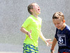 HOLLY PELCZYNSKI - BENNINGTON BANNER Colby Jensen, of Manchester catches water in his mouth while at Totus tuus camp at Sacred Heart St. Francis De Sales church in Bennington on Friday afternoon during their water day celebration, held in Bennington.