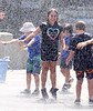 HOLLY PELCZYNSKI - BENNINGTON BANNER 4th grader Aubrey Croff cools off during the Totus tuus camp at Sacred Heart St. Francis De Sales church in Bennington on Friday afternoon during their water day celebration, held in Bennington.