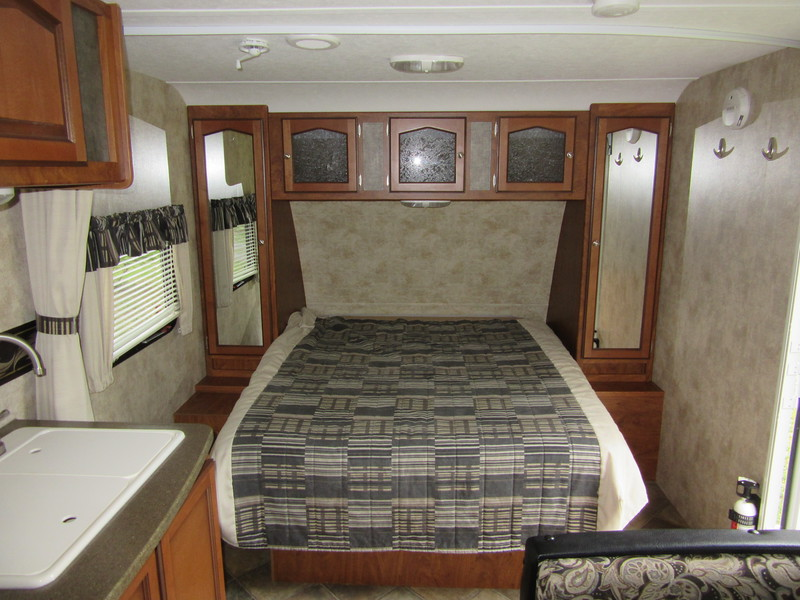 Nice bed. Mirrored panels are closets. Storage above the bed too.