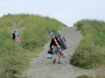 Pack mule Turner heading up the sand dune to get to the beach