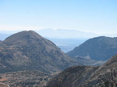 Looking east past Tioga Peak out at Owens Valley and the White Mountains. A portion of Ellery Lake is visible just above the near ridge.