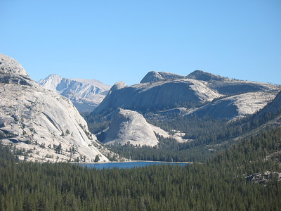 Mount Conness is a cool looking peak. This is the first view you get when driving in from the west. Mount Conness is on the horizon, between the domes on either side of Tenaya Lake. This view is from Hwy 120, just past Olmstead Point.