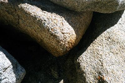 Eroded granite, gaps, shadows.