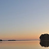 Morning sunrise over Clarks Hill lake from campsite. This was my first attempt at creating a panorama shot using multiple images. This was made from 5 images shot from a tripod, though the head is a full ball so I had to keep as level as possible. I used autopano to create the points to attach the images and Hugin software to actually stitch them together.