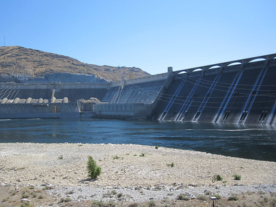 The dam with part of power plant 2 and part of 3. Interesting facts: It is the largest electric power-producing facility in the United States and one of the largest concrete structures in the world at 12 million cubic yards