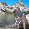 Dan Diligently Pumping Water