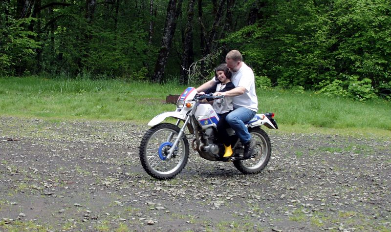 """<font size=""""+1"""">If you know me, then you probably have noticed that where ever I am, there seems to be at least one motorcycle of some kind, and this was no exception.  Of course we have to give the kids rides around the camp..  WHEEEEE! </font>"""