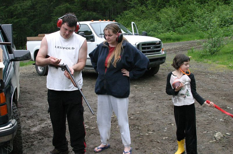 """<font size=""""+1"""">Rex is one of the more safety conscious gun owners that I know.,..  Here he carefully instructs someone who just ten minutes before was saying things like """"I don't get it"""" and """"why do you want to do this, anyway?"""" on the basics of firearm safety. </font>"""