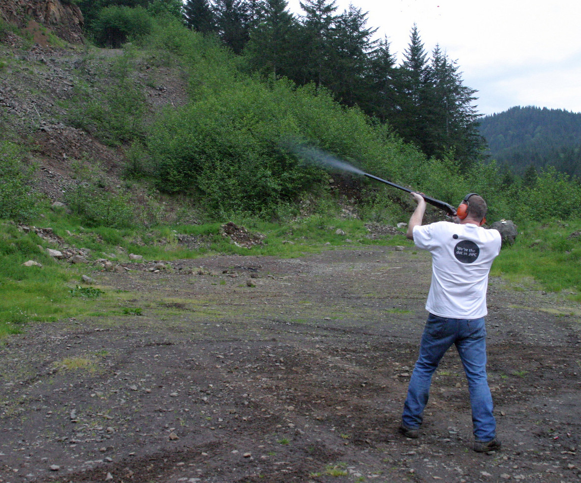 "<font size=""+1"">Sarah is doing a GREAT job as a photojournalist, catching the very moment of skeet destruction! </font>"