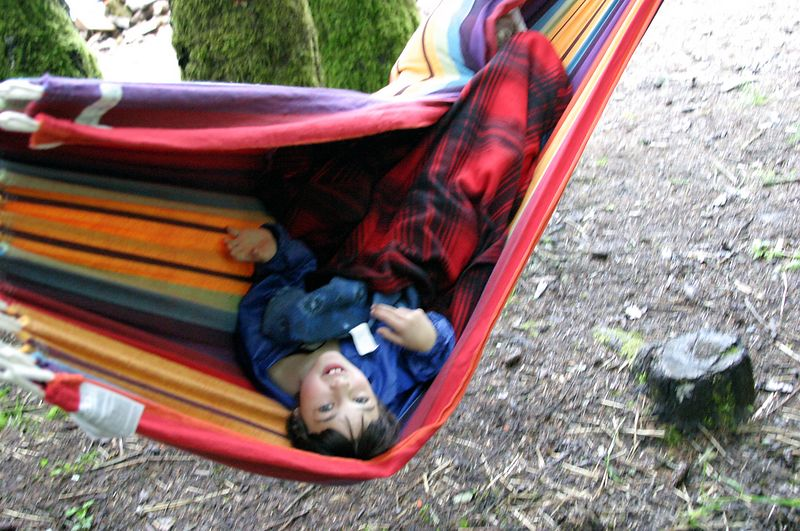"<font size=""+1"">Later back at camp we try to get the kids to take a nap in a hammock.  How stupid is that?  All they could do was turn it into fun time in the swinging bed. </font>"