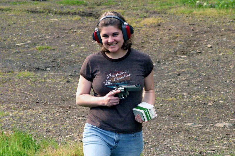 "<font size=""+1"">Okay, all kidding aside, here's Nica showing off her 2005 birthday present, a really nasty/cool 357 pistol... </font>"