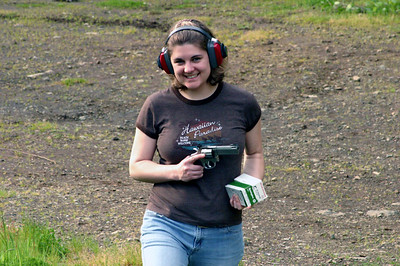 Okay, all kidding aside, here's Nica showing off her 2005 birthday present, a really nasty/cool 357 pistol...