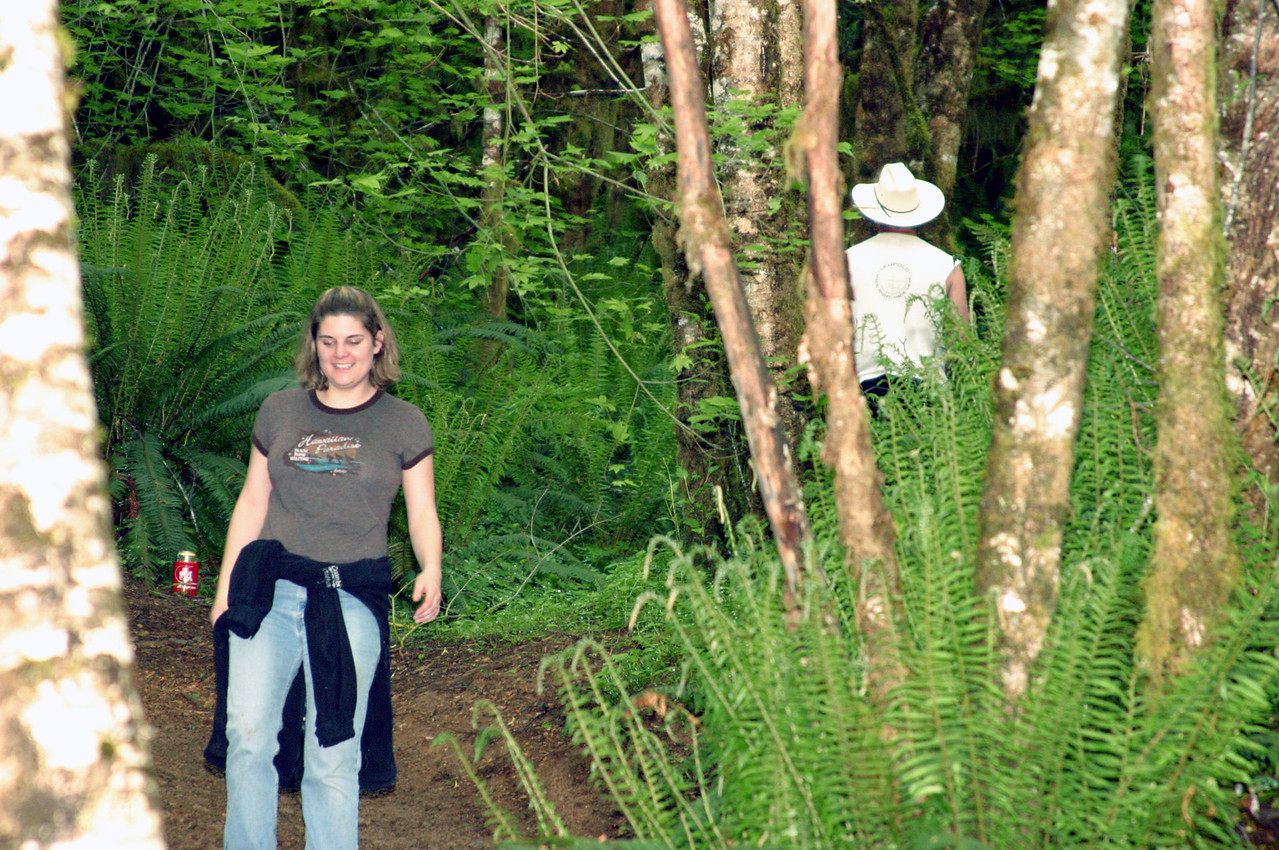"""<font size=""""+1"""">So, this is so funny..  Well, after I explain it it is..   Well, if you like """"potty humor""""..  ;-)   We're walking down the trail and Shawn and Nica drop back for a while.  After the rest of us have walked up the trail a bit I turn around, and there's Nica, squatin' in the middle of the trail doing her duty.  Not being prepared, I don't get """"Photojournalistic Proof"""", but we all get a good laugh and get to listen to Nica give Shawn a hard time for convincing her that no one would turn around.  Geeze, there were lots of trees nearby..  Anyway, we're not 100 yards further down the trail, and next thing I hear is Nica giving Rex a hard time for not finding a better tree to hide behind.  This time I'm prepared! <p> <font size=""""+1""""> Sheesh, you'd think Rex could find a bigger tree to hide behind.  ;-) </font>"""