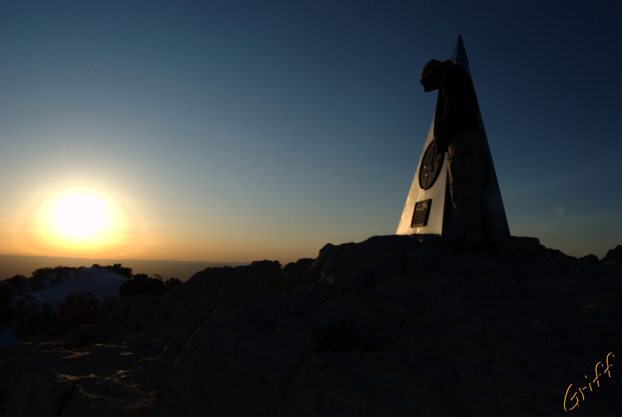 It was windy and cold on the peak at sunset, but well worth the view.  I am trying to hide from the wind by standing next to the monument to American Airlines.  It is shaped like a triangle, so it doesn't work great, but it helped.  (Unedited photo!)