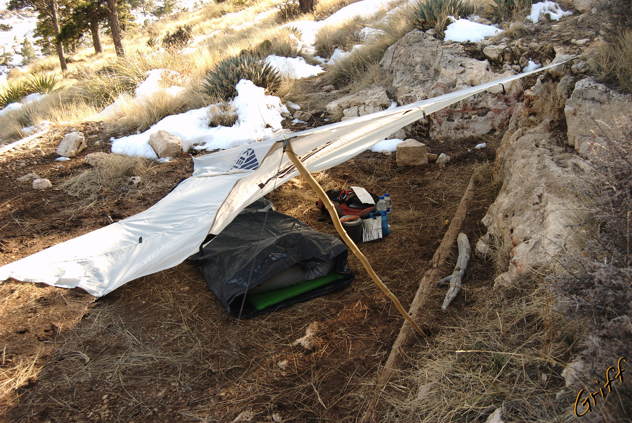 Before I packed, I decided I was going to be more minimalist than usual.  This is what I came up with.  A tarp with two trash bags taped together to make an ultralight bivy.  Turns out, that bivy captures too much moisture inside and makes my sleeping bag wet.  It was a good try though.