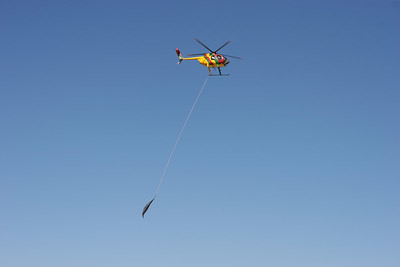 The helicopter moving supplies.