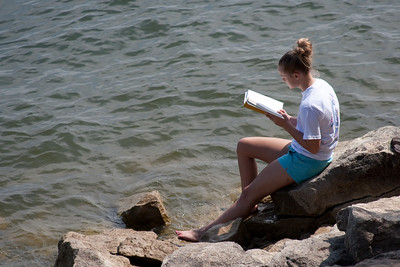Meagan reading by the lake