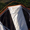 There are no sleeves to run poles through on this tent, it is all done with plastic clips. I started at the top rear.