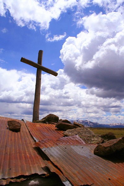 A cross on top of a sheep shelter on top of Cornwall Mountain near Platoro, CO.