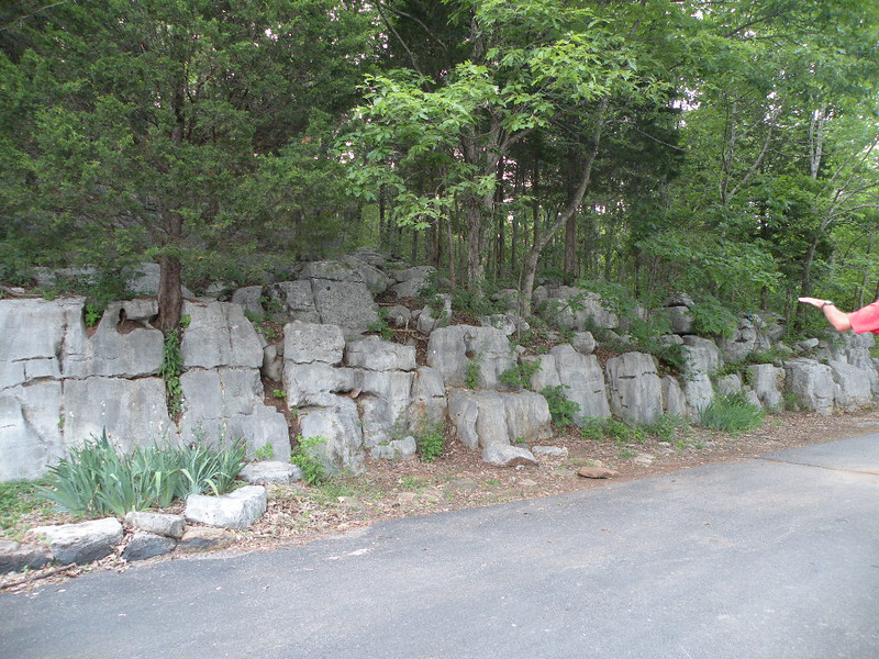 The rock at the edge of the parking lot looks like it was man made, but it formed this way.