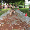 A young girl tries out the chocolate Slip N Slide at the Jellystone Park in South Haven, Michigan. Photo courtesy of the Jellystone Park in South Haven.