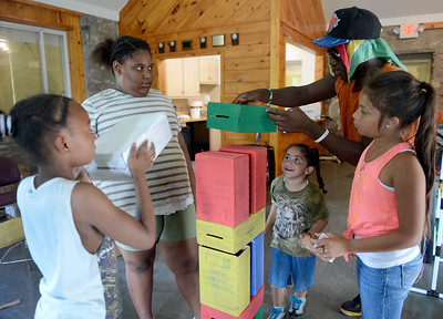 Tania Barricklo-Daily Freeman                      Kingston City Parks and Recreation Summer Camps are each creating their own Leggo -themed float for Friday's Children's Parade. From left are Hasbrouck Park campers: Eniah Leasure,9, Jon'nae Wright,11, Marlo Brandon Jr., 5, being given a hand by their counselor Leroy Peters, and Olivia Amasifuen,11.