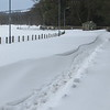 Glen road drifts show the snow blown off the fields