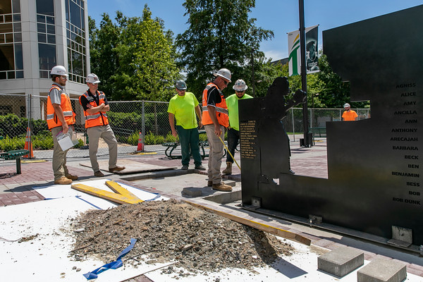 The bronze figure panels are installed at the Enslaved People of George Mason Memorial in Wilkins Plaza. Photo by: Shelby Burgess/Strategic Communications/George Mason University