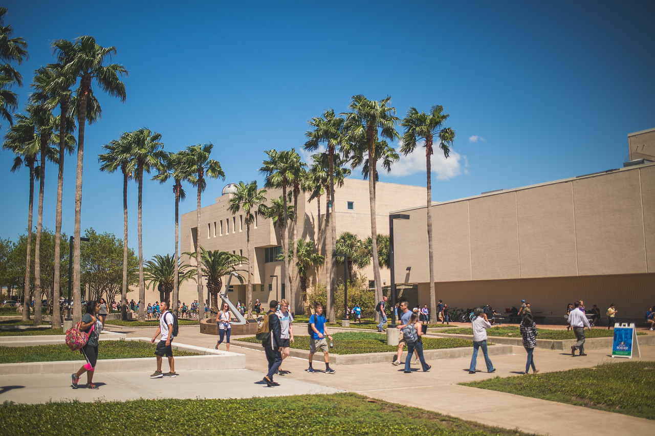 Students walk across Anchor Plaza during the lunch hour on the Island Campus.
