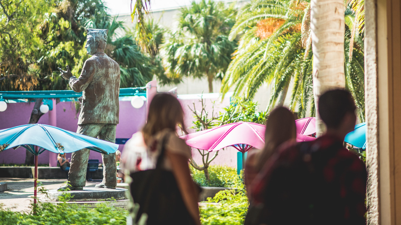 Students walk by the Hector P. Garcia plaza as they make their way through the breezeway.