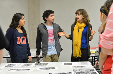 Dr.Jullia Curran and her students discuss about the art work done by others in Design I classs