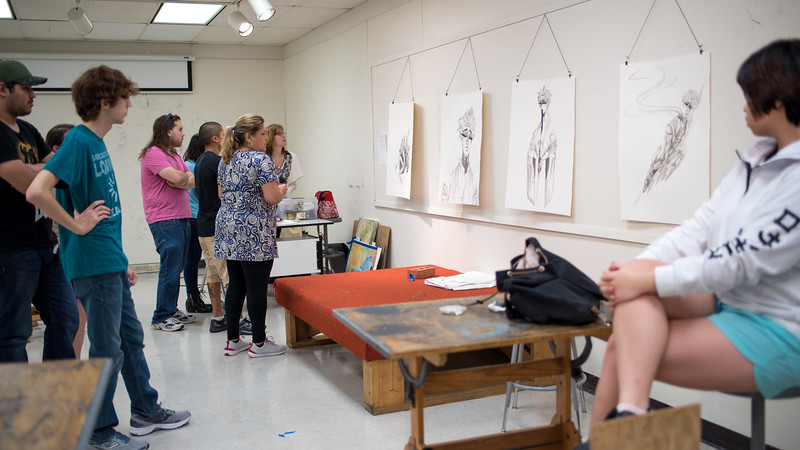 Students critique their peer's artwork during Advanced Drawing.
