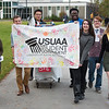 """USUAA and their cart as UAA's Homecoming Shopping Cart Parade makes its way through the Student Union, Wells Fargo Sports Complex, and Cuddy Quad.  <div class=""""ss-paypal-button"""">181008-SHOPPING CART PARADE-JRE-0499.jpg</div><div class=""""ss-paypal-button-end""""></div>"""