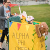 """UAA's Homecoming Shopping Cart Parade makes its way through the Student Union, Wells Fargo Sports Complex, and Cuddy Quad.  <div class=""""ss-paypal-button"""">181008-SHOPPING CART PARADE-JRE-0447.jpg</div><div class=""""ss-paypal-button-end""""></div>"""